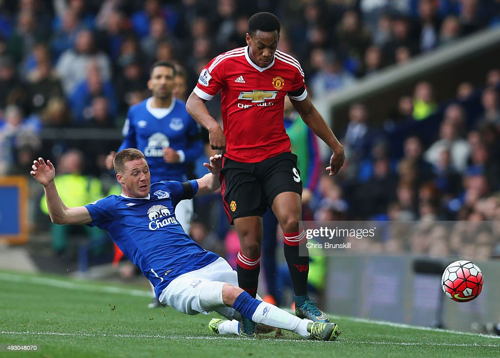 <a gi-track='captionPersonalityLinkClicked' href=/galleries/search?phrase=Anthony+Martial&family=editorial&specificpeople=9197434 ng-click='$event.stopPropagation()'>Anthony Martial</a> of Manchester United is tackled by <a gi-track='captionPersonalityLinkClicked' href=/galleries/search?phrase=James+McCarthy+-+Soccer+Player&family=editorial&specificpeople=8984734 ng-click='$event.stopPropagation()'>James McCarthy</a> of Everton during the Barclays Premier League match between Everton and Manchester United at Goodison Park on October 17, 2015 in Liverpool, England.