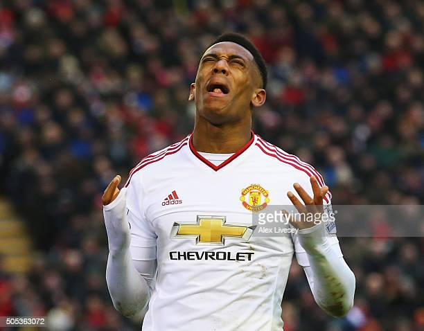 Anthony Martial of Manchester United reacts after failing to score during the Barclays Premier League match between Liverpool and Manchester United...