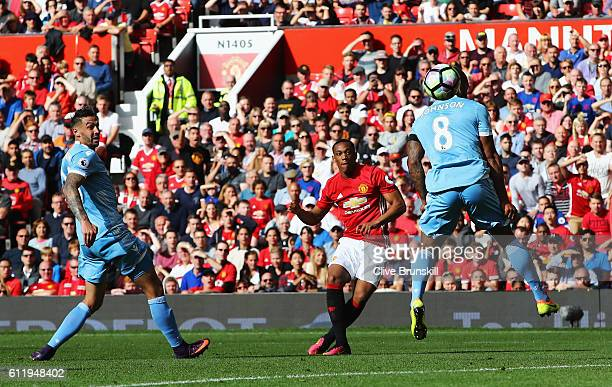 Anthony Martial of Manchester United scores his sides first goal during the Premier League match between Manchester United and Stoke City at Old...