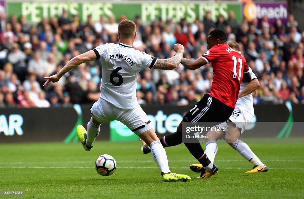 Anthony Martial of Manchester United scores his sides fourth goal during the Premier League match between Swansea City and Manchester United at Liberty Stadium on August 19, 2017 in Swansea, Wales.