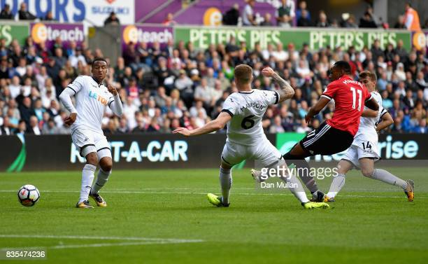 Anthony Martial of Manchester United scores his sides fourth goal during the Premier League match between Swansea City and Manchester United at...