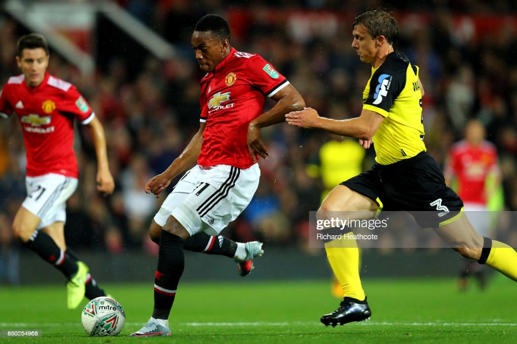Anthony Martial of Manchester United scores his sides fourth goal during the Carabao Cup Third Round match between Manchester United and Burton Albion at Old Trafford on September 20, 2017 in Manchester, England.