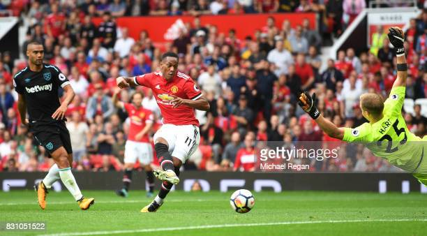 Anthony Martial of Manchester United scores his sides third goal past Joe Hart of West Ham United during the Premier League match between Manchester...