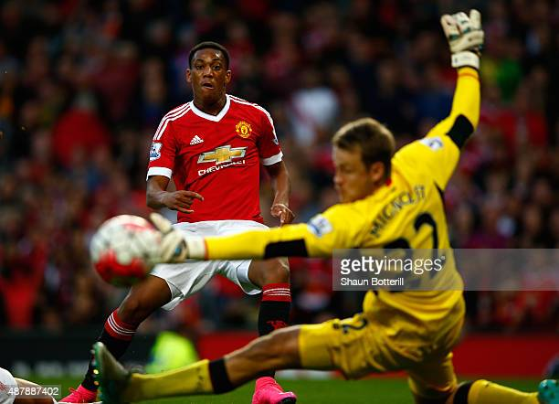 Anthony Martial of Manchester United scores past Simon Mignolet of Liverpool for his team's third goal during the Barclays Premier League match...