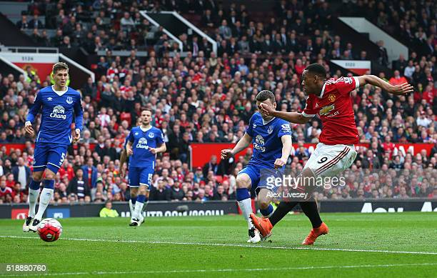 Anthony Martial of Manchester United scores their first goal during the Barclays Premier League match between Manchester United and Everton at Old...