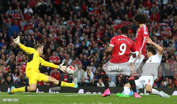 Anthony Martial of Manchester United scores their third goal during the Barclays Premier League match between Manchester United and Liverpool on...