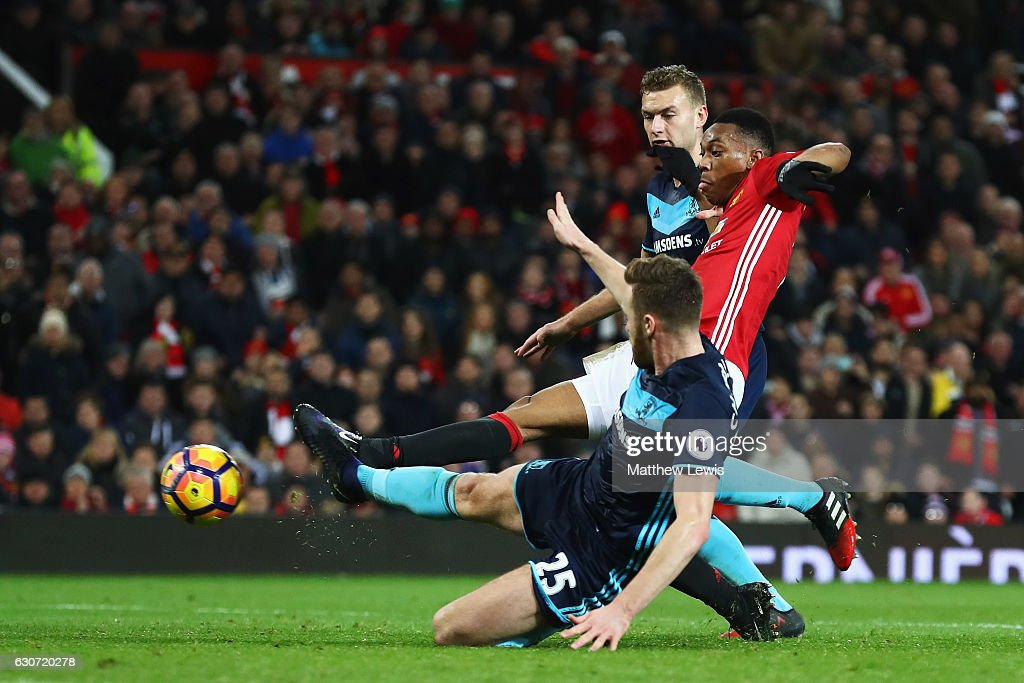 Anthony Martial of Manchester United shoots and scores a goal during the Premier League match between Manchester United and Middlesbrough at Old Trafford on December 31, 2016 in Manchester, England.
