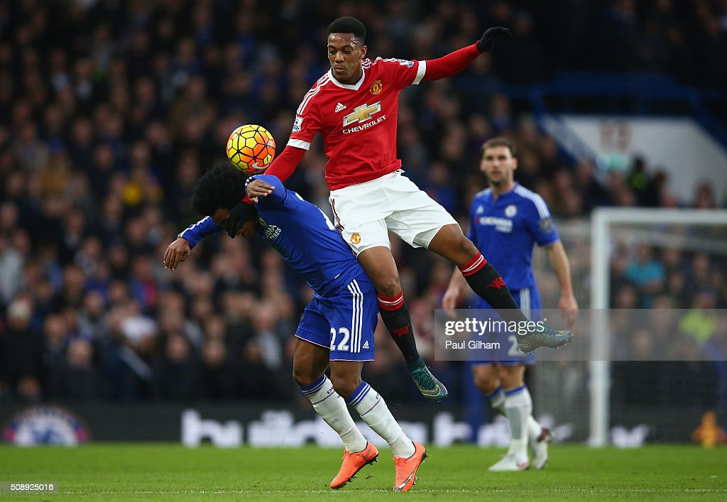 <a gi-track='captionPersonalityLinkClicked' href=/galleries/search?phrase=Anthony+Martial&family=editorial&specificpeople=9197434 ng-click='$event.stopPropagation()'>Anthony Martial</a> of Manchester United tackles <a gi-track='captionPersonalityLinkClicked' href=/galleries/search?phrase=Willian+-+Soccer+Player+for+Chelsea+and+Brazil&family=editorial&specificpeople=9886576 ng-click='$event.stopPropagation()'>Willian</a> of Chelsea during the Barclays Premier League match between Chelsea and Manchester United at Stamford Bridge on February 7, 2016 in London, England.