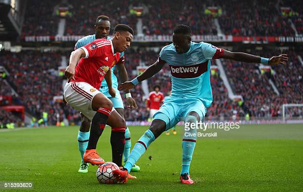 Anthony Martial of Manchester United takes on Cheikhou Kouyate of West Ham United during the Emirates FA Cup sixth round match between Manchester...