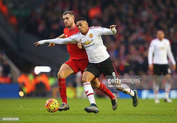 Anthony Martial of Manchester United takes on Jordan Henderson of Liverpool during the Barclays Premier League match between Liverpool and Manchester...
