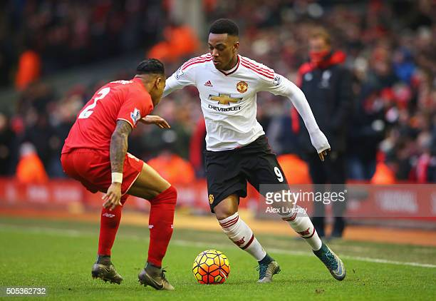 Anthony Martial of Manchester United takes on Nathaniel Clyne of Liverpool during the Barclays Premier League match between Liverpool and Manchester...