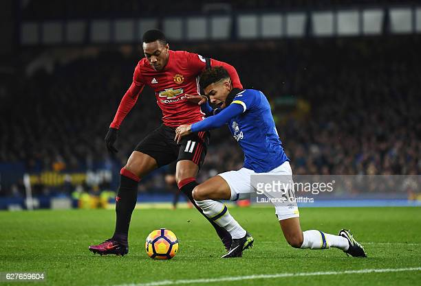 Anthony Martial of Manchester United tangles with Mason Holgate of Everton during the Premier League match between Everton and Manchester United at...