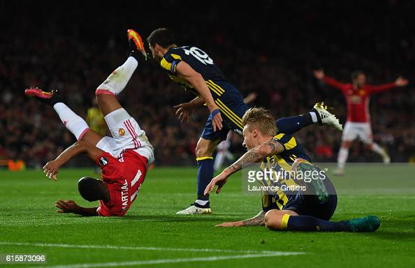 Anthony Martial of Manchester United wins a penalty as he is brought down by Sener Ozbayrakli of Fenerbahce during the UEFA Europa League Group A...