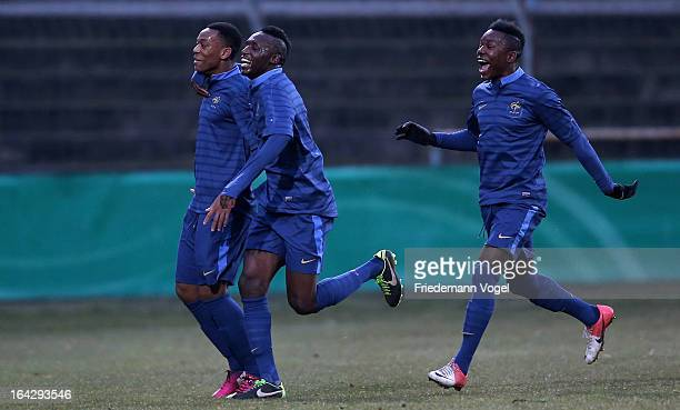 Anthony Martial Seko Fofana and Louis Nganioni of France celebrate their team's second goal during the U18 International Friendly match between...