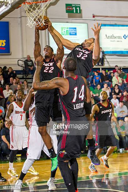 Anthony Mason Jr #22 Craig Smith and DeAndre Liggins of the Sioux Falls Skyforce battle for a rebound against the Maine Red Claws on March 30 2014 at...