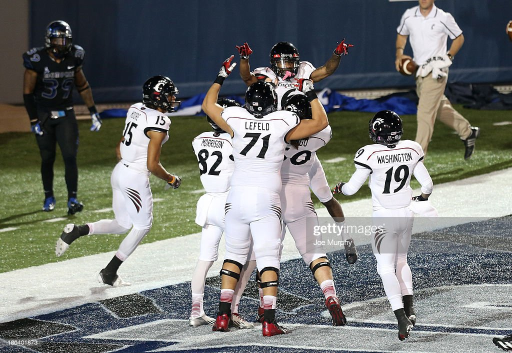 Anthony McClung #6 of the Cincinnati Bearcats celebrates his touchdown reception with teammates against the Memphis Tigers on October 30, 2013 at Liberty Bowl Memorial Stadium in Memphis, Tennessee. Cincinnati beat Memphis 34-21.