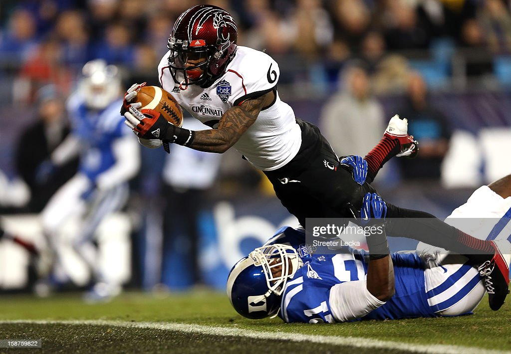 Anthony McClung #6 of the Cincinnati Bearcats dives for a touchdown as Anthony Young-Wiseman #21 of the Duke Blue Devils tries to make a stop on the goal ine during their game at Bank of America Stadium on December 27, 2012 in Charlotte, North Carolina.