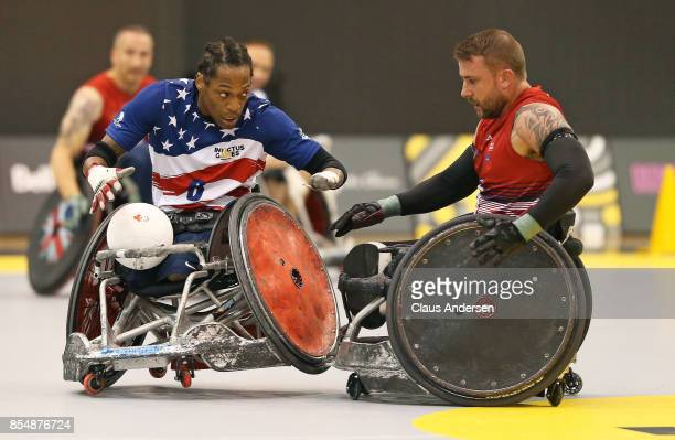 Anthony McDaniel of Team USA battles against Clive Smith of Team United Kingdom in action on Day Five at Wheelchair Rugby during the 2017 Invictus...