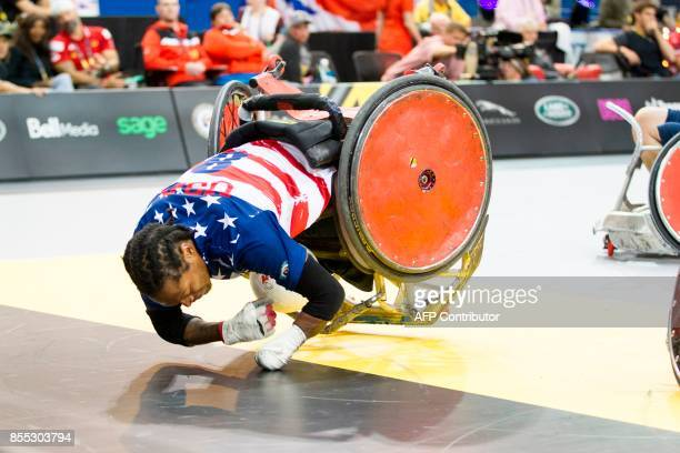 Anthony McDaniel of the United States topples over the goal line during the US's bronze medal wheelchair rugby match against Denmark at the Invictus...