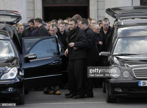Anthony McDonagh is helped into a car during the funeral of sons James Anthony and Martin McDonagh at Our Lady of Lourdes Church in Drogheda The...