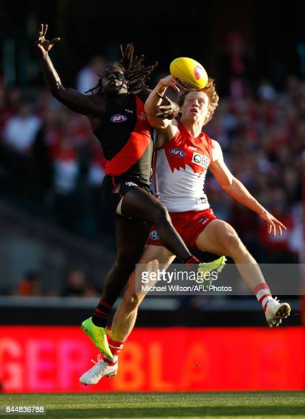 Anthony McDonaldTipungwuti of the Bombers and Callum Mills of the Swans compete for the ball during the AFL Second Elimination Final match between...