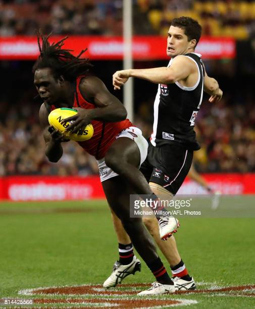 Anthony McDonaldTipungwuti of the Bombers and Leigh Montagna of the Saints compete for the ball during the 2017 AFL round 17 match between the St...