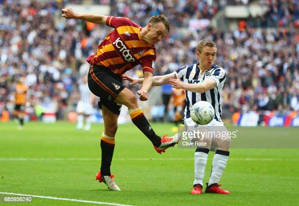 Anthony McMahon of Bradford City beats Shane Ferguson of Millwall during the Sky Bet League One Playoff Final between Bradford City and Millwall at...