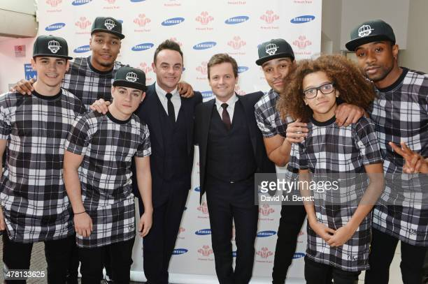 Anthony McPartlin and Declan Donnelly aka Ant and Dec pose with members of British dance troop Diversity at The Prince's Trust Samsung Celebrate...