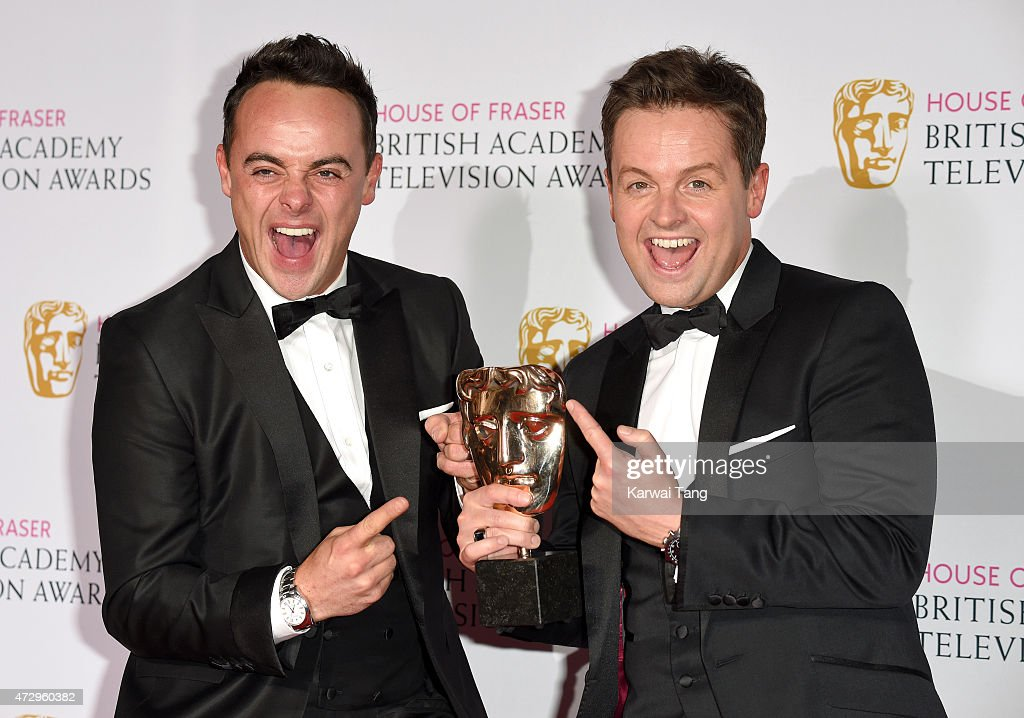 Anthony McPartlin (L) and Declan Donnelly, winners of Best Entertainment Programme for 'Ant & Dec Saturday Night Takeaway', pose in the winners room at the House of Fraser British Academy Television Awards at Theatre Royal on May 10, 2015 in London, England.