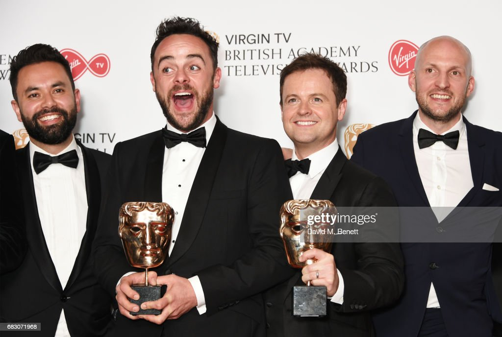 Anthony McPartlin (2L) and Declan Donnelly (2R), winners of the Entertainment Programme award for 'Ant and Dec's Saturday Night Takeaway' pose with cast and crew in the Winner's room at the Virgin TV BAFTA Television Awards at The Royal Festival Hall on May 14, 2017 in London, England.
