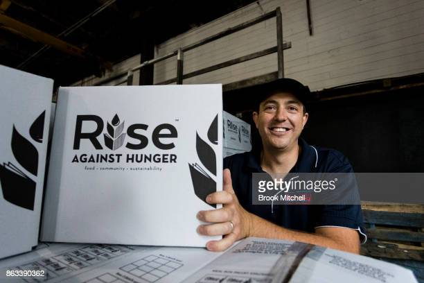 Anthony Meyer lends a hand during Zambrero's meal packing day on October 20 2017 in Sydney Australia More than 1700 volunteers across Australia come...
