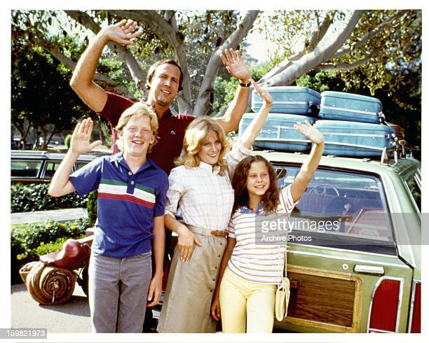 Anthony Michael Hall Chevy Chase Beverly D'Angelo and Dana Barron waving from car in a scene from the film 'Vacation' 1983