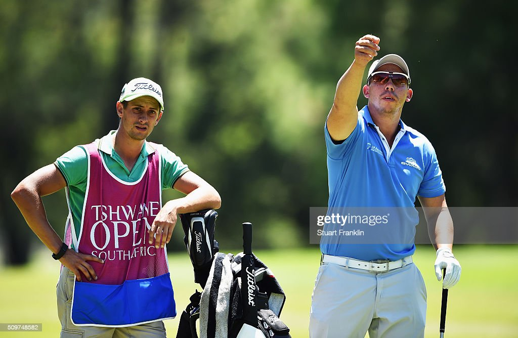 Anthony Michael of South Africa and caddie ponder a shot during the second round of the Tshwane Open at Pretoria Country Club on February 12, 2016 in Pretoria, South Africa.