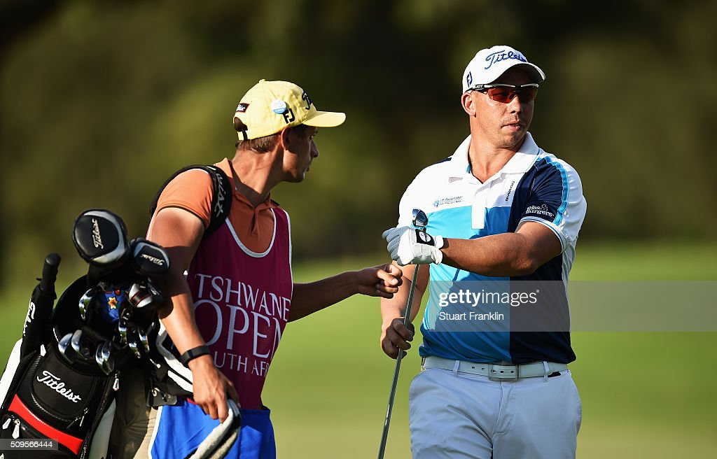 Anthony Michael of South Africa bumps fists with his caddie during the first round of the Tshwane Open at Pretoria Country Club on February 11, 2016 in Pretoria, South Africa.