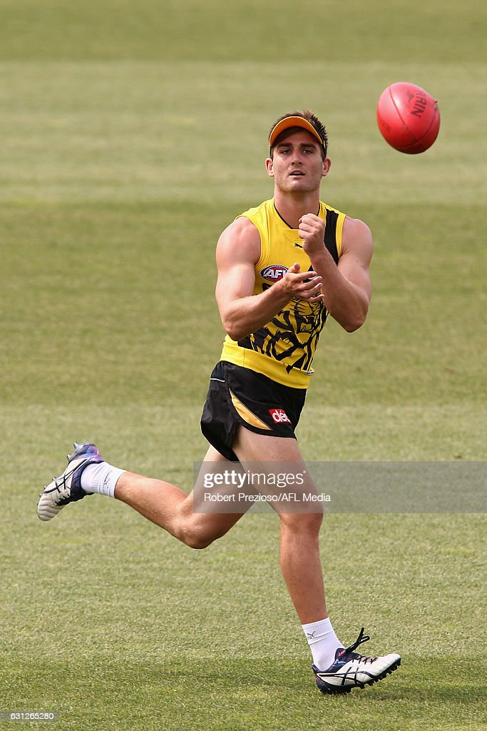 Anthony Miles handballs during a Richmond Tigers AFL training session at ME Bank Centre on January 9, 2017 in Melbourne, Australia.