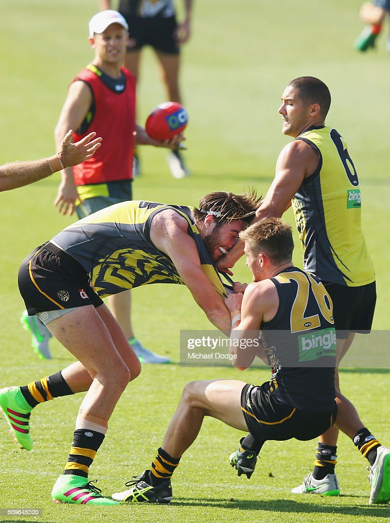 Anthony Miles of the Tigers and Liam McBean of the Tigers (R) wrestle on during the Richmond Tigers AFL intra-club match at Punt Road Oval on February 12, 2016 in Melbourne, Australia.
