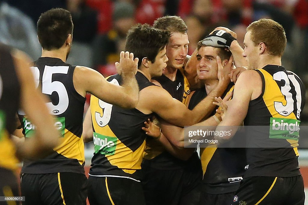 Anthony Miles (C) of the Tigers celebrates a goal with teamates during the round 14 AFL match between the Richmond Tigers and the Sydney Swans at Melbourne Cricket Ground on June 20, 2014 in Melbourne, Australia.