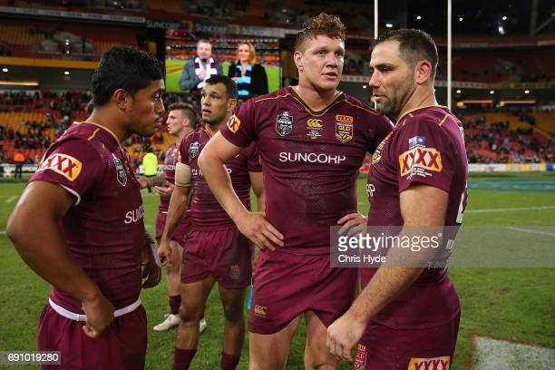 Anthony Milford Dylan Napa and Cameron Smith of the Maroons look on after losing game one of the State Of Origin series between the Queensland...