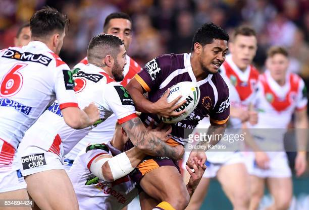 Anthony Milford of the Broncos attempts to breaks through the defence during the round 24 NRL match between the Brisbane Broncos and the St George...