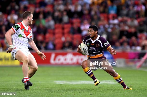 Anthony Milford of the Broncos breaks away from the defence during the round 24 NRL match between the Brisbane Broncos and the St George Illawarra...