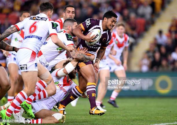 Anthony Milford of the Broncos breaks through the defence during the round 24 NRL match between the Brisbane Broncos and the St George Illawarra...