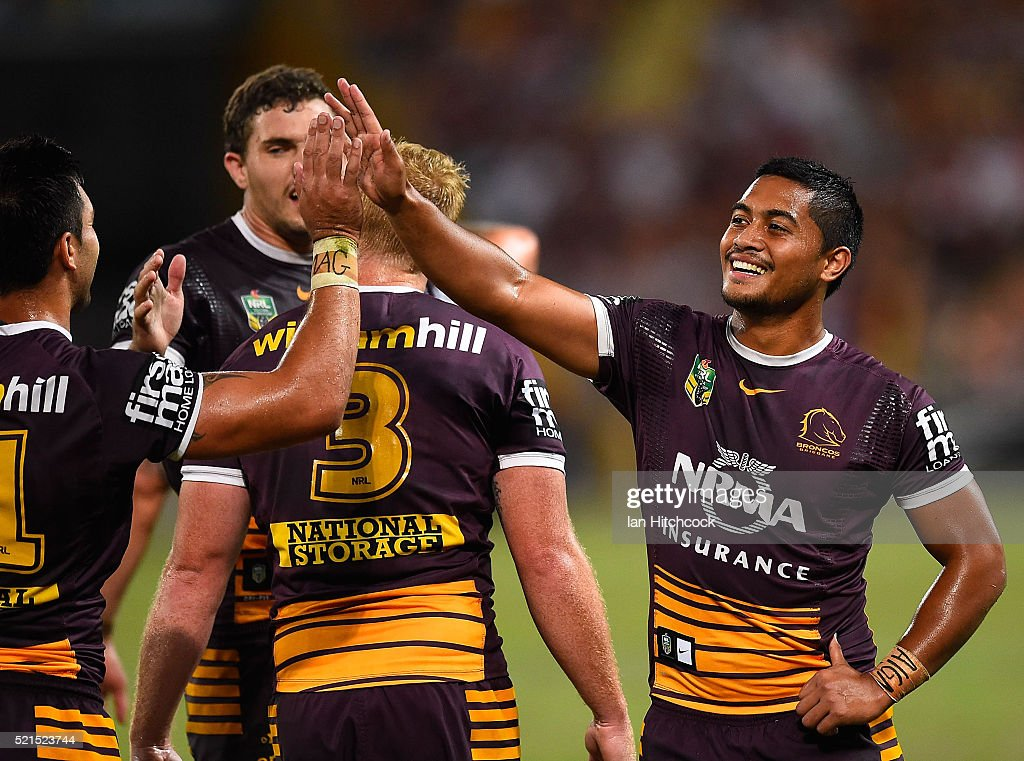 Anthony Milford of the Broncos celebrates the try of Corey Oats of the Broncos during the round seven NRL match between the Brisbane Broncos and the Newcastle Knights at Suncorp Stadium on April 16, 2016 in Brisbane, Australia.