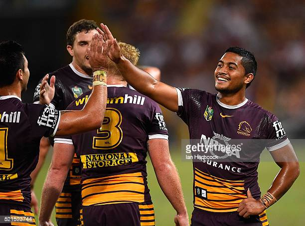 Anthony Milford of the Broncos celebrates the try of Corey Oats of the Broncos during the round seven NRL match between the Brisbane Broncos and the...