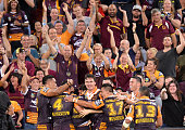 Anthony Milford of the Broncos celebrates with team mates after kicking the winning field goal in golden point extra time during the round four NRL...