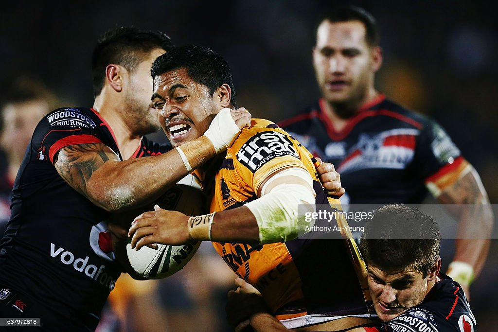 Anthony Milford of the Broncos is tackled by Shaun Johnson and Blake Ayshford of the Warriors during the round 13 NRL match between the New Zealand Warriors and the Brisbane Broncos at Mt Smart Stadium on June 4, 2016 in Auckland, New Zealand.