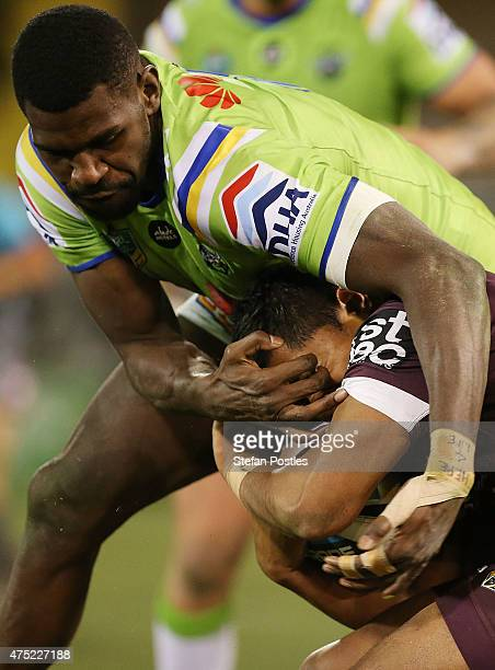 Anthony Milford of the Broncos is tackled during the round 12 NRL match between the Canberra Raiders and the Brisbane Broncos at GIO Stadium on May...