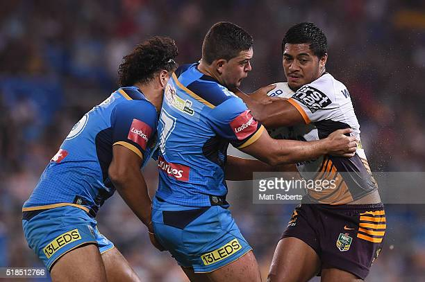 Anthony Milford of the Broncos is tackled during the round five NRL match between the Gold Coast Titans and the Brisbane Broncos at Cbus Super...