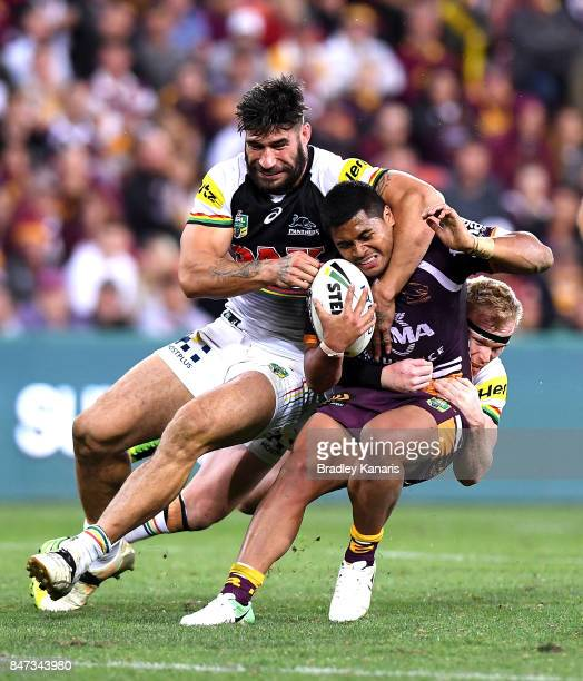 Anthony Milford of the Broncos is wrapped up by the defence during the NRL Semi Final match between the Brisbane Broncos and the Penrith Panthers at...