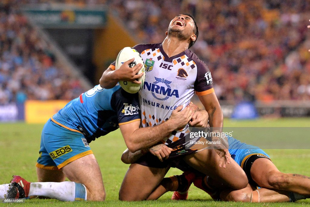 Anthony Milford of the Broncos looks to be in pain as he is tackled during the round seven NRL match between the Brisbane Broncos and the Gold Coast Titans at Suncorp Stadium on April 14, 2017 in Brisbane, Australia.