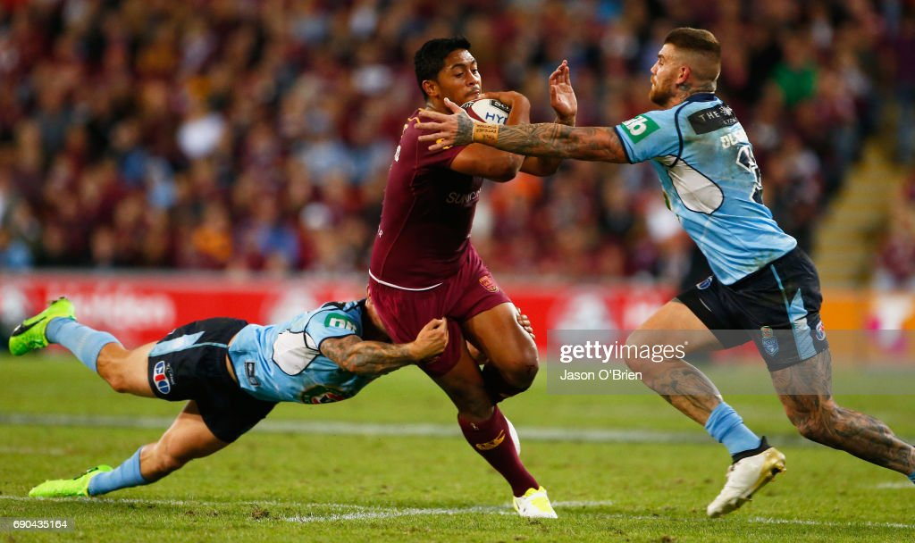 Anthony Milford of the Maroons runs at Josh Dugan of the Blues during game one of the State Of Origin series between the Queensland Maroons and the New South Wales Blues at Suncorp Stadium on May 31, 2017 in Brisbane, Australia.